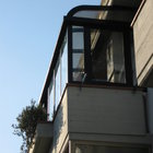 Veranda in alluminio ossidato nero, tetto curvo in policarbonato a doppia parete [1]